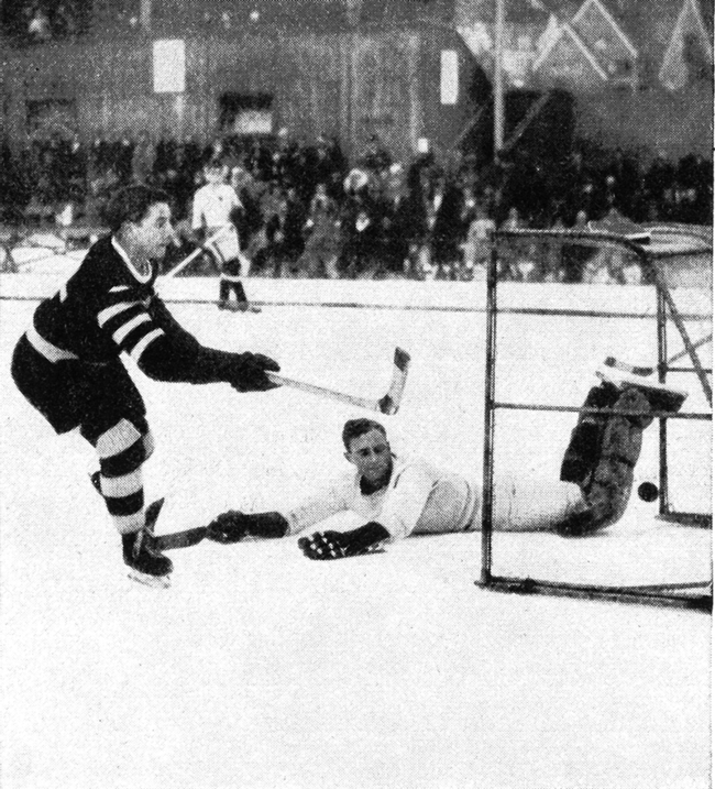 Rudi Ball shoots and scores at the Spengler-Cup in 1931. The Sprengler-Cup is the oldest international ice hockey tournament in the world.