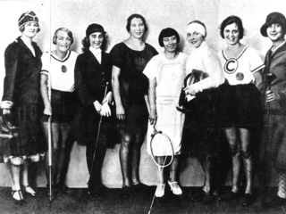 "In October 1925 at a press ball the Berliner Illustrirte magazine presented the ""Greatest Female Athletes"". Nelly Neppach (fourth from the right) is pictured here standing next to track and field athlete Lilli Henoch (fourth from the left)."