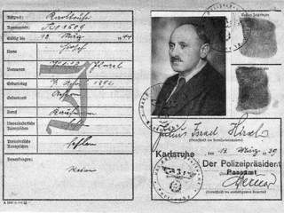 "Julius Hirsch's pass pictured here stamped with a ""J"" for ""Jewish"" and the forced middle name of ""Israel"". These labels were part of legal repression against German Jewish citizens, making it easier for Nazi authorities to disenfranchise and persecute."